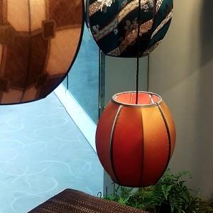 Corner window lampshade display at Abbott & Boyd Showrooms.