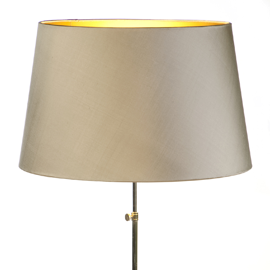 Laminated gold lampshade with shiny gold interior
