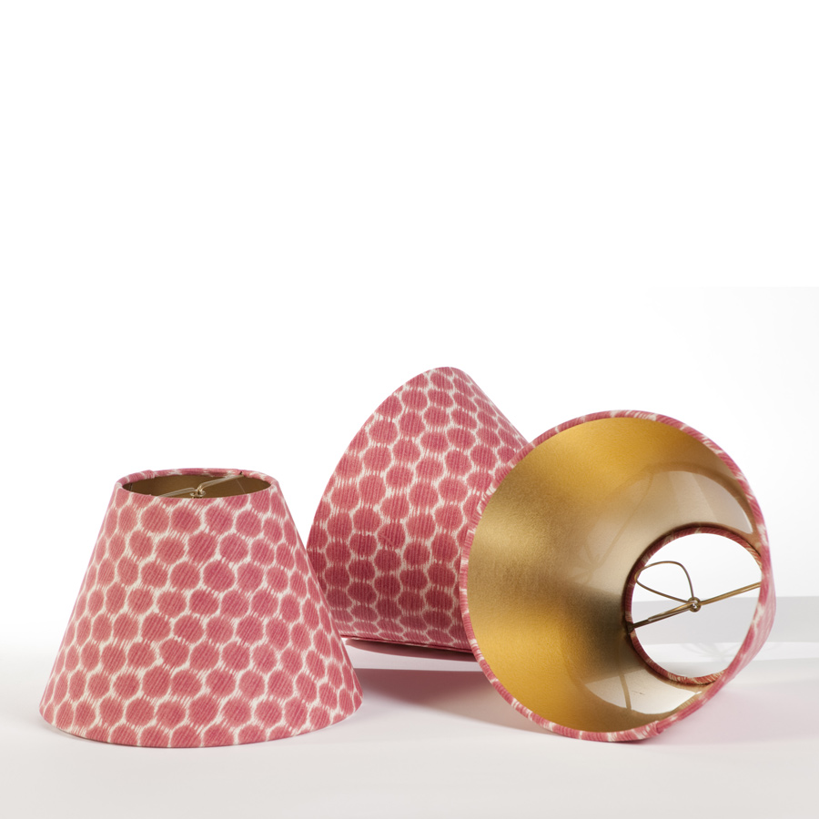 Small red and white print candle clip lampshades with shiny gold interior