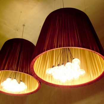 Large gathered red and gold lampshades