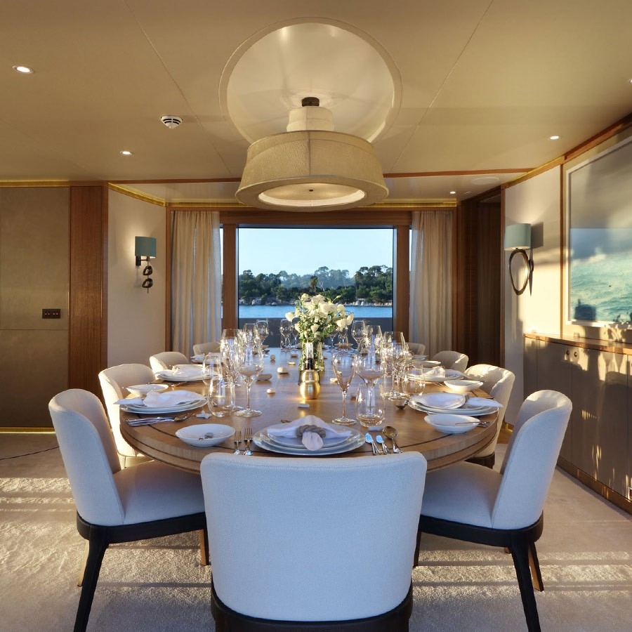 Special bespoke asymmetric pendant piece above dining table on super yacht