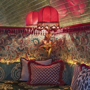 Red silk with fringe lampshades at Annabel's Private Members Club in London. Created by A Shade Above in collaboration with Martin Brudnizki Design Studio